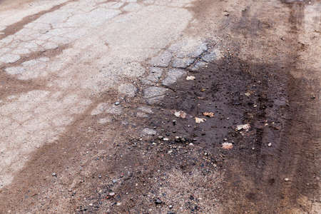 poor-quality road surface that has become completely worthless. Close-up photograpy