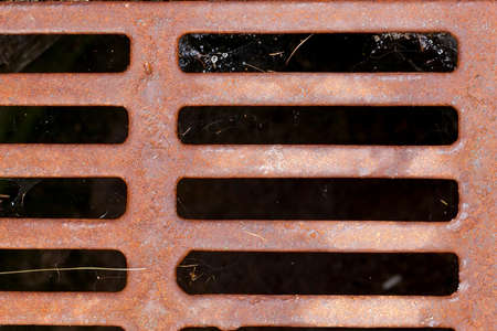 rusty metal grate on the street, close-up Stock Photo