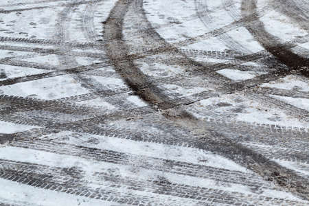 ruts on white snow tracks from the wheels of cars ,Winter season. The road is covered with snow after snowfall
