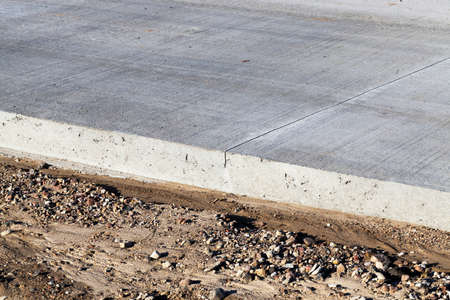 part of the road made of concrete, closeup of the edge of the roadway Stock Photo