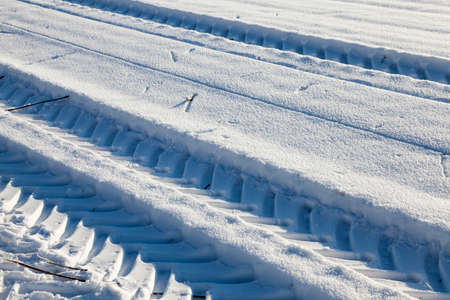 snow covered road in the winter season , Closeup photo