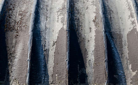 black corrugated part of the wall of the building used for food storage, details and closeup Stock Photo