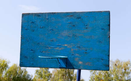 blue basketball shield of wooden sticks and a metal ring for playing basketball, countryside on a background of blue sky Stock Photo