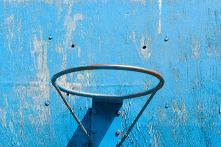 blue basketball ring on the background of a blue wooden shield on the street, closeup Stock Photo