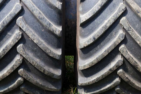 connected together two heavy large rubber wheels of the tractor, that it would have a great patency and not be stuck in the mud on the field