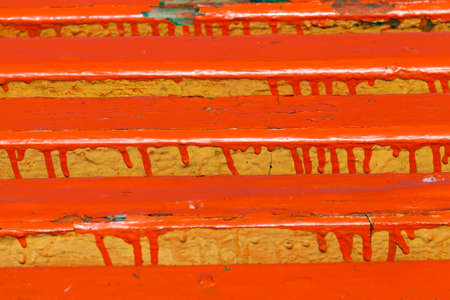 badly painted board benches for outdoor recreation, close-up of wooden construction in the park