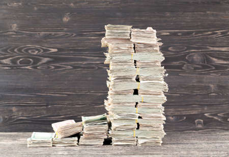 a lot of paper cash lays together in a big pile Stockfoto