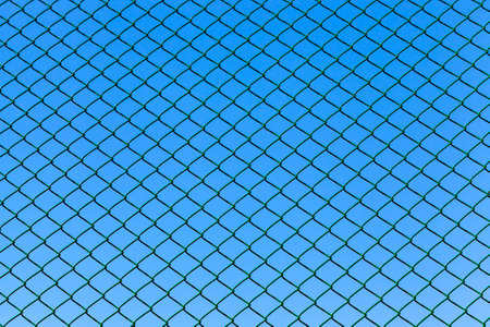 metal grill against the blue sky, fenced territory