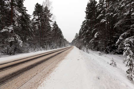 snow-covered road in the winter season. Close-up photo