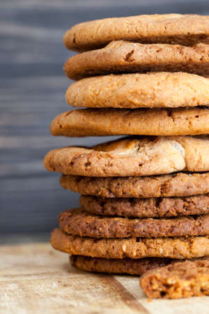 round shaped tasty oatmeal cookies round shaped lying on a wooden table, biscuits dry and crumbled Stock Photo