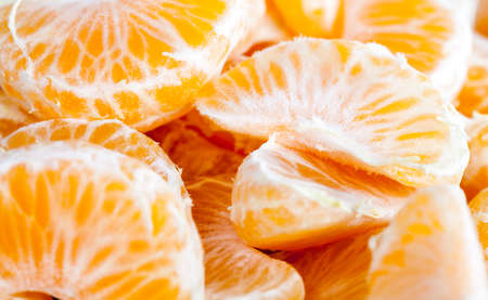 delicious tangerines, peeled orange peel lying on a wooden table, healthy citrus fruits with lots of vitamins