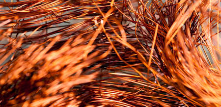 Orange abstract background of copper wire twisted in a chaotic manner