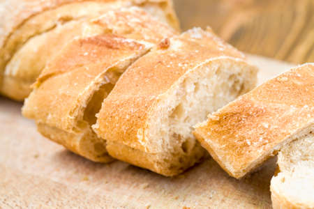 fresh fragrant and soft flesh cut into pieces of bread from real flour , bread from different varieties of flour has a light color
