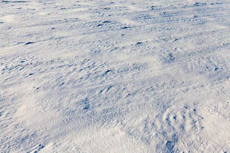 snow-covered soil surface close up - snow-covered soil surface is not smooth. Photographed close-up. 版權商用圖片
