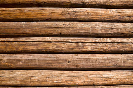 old wooden background which is the roof of an old village building, close-up rough construction 스톡 콘텐츠