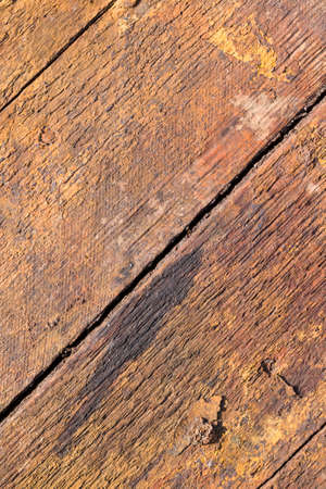 old dirty boards with orange rust-like color, close-up of planked background Фото со стока