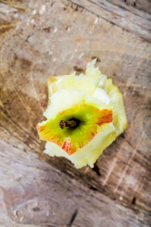 one stump of ripe red Apple on a chopping Board, close - up of food top view