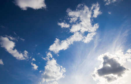 beautiful blue sky and sunlight with white bright clouds illuminated by sunlight, landscape in nature