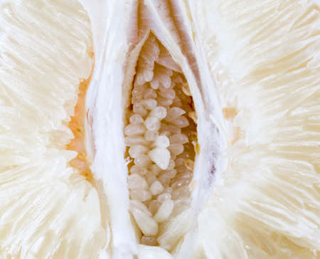 white juicy and sweet flesh of grapefruit or pomelo, closeup of healthy fruits, c