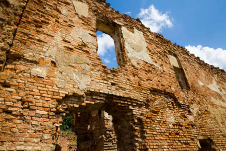 empty window openings in an abandoned ruined red brick building 写真素材