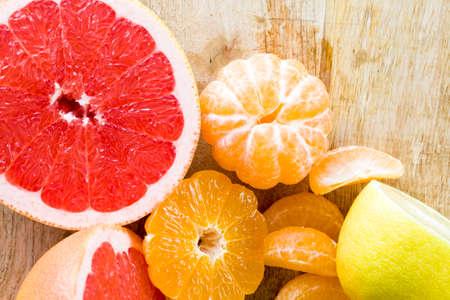 red juicy grapefruit cut in half across, close-up of ripe sour healthy citrus Stock fotó