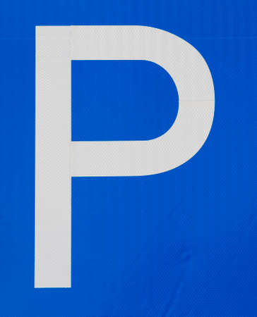 car road sign indicating the place to Park the car, white letter P on a blue background, traffic control on the roads