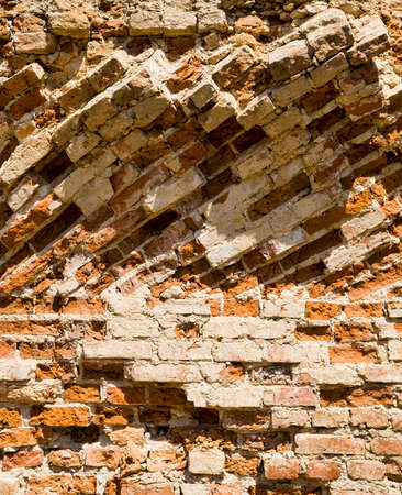 details of the ruined fortress wall of the red brick castle, an abandoned building in Europe 写真素材