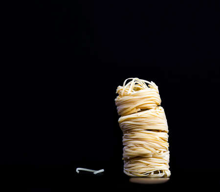 pasta in raw dried form, real noodles and pasta, close-up in the kitchen 写真素材