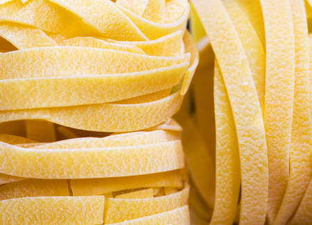 made from wheat flour pasta, durum wheat, close-up in the kitchen before cooking raw pasta