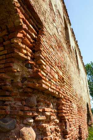 closeup of a ruined castle wall or red brick fortress, an abandoned structure in Europe