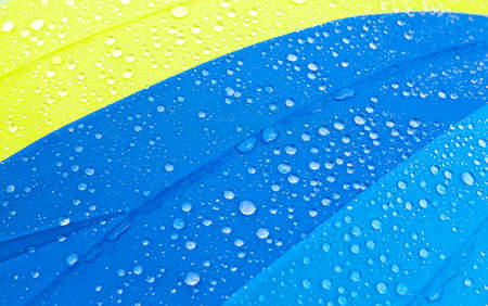 water drops on a colorful umbrella after the rain