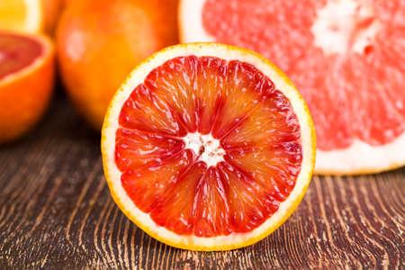 red orange delicious orange fruit, cut into halves during the preparation of desserts Stock Photo