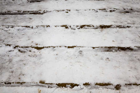 old stairs on the road covered with snow after snowfall, winter frosty weather in the city