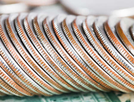 a stack of old American quarter dollar coins, a close-up of metal money with flaws and defects worth 25 cents Stock Photo