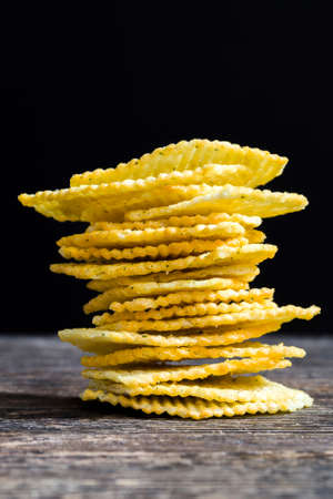 chips in spices and flavorings to improve the taste, ordinary potato chips with a corrugated surface