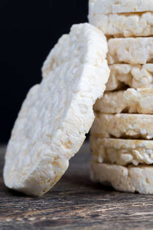 stacked together made from processed rice tasteless natural rice loaves are used in dietary nutrition, close-up