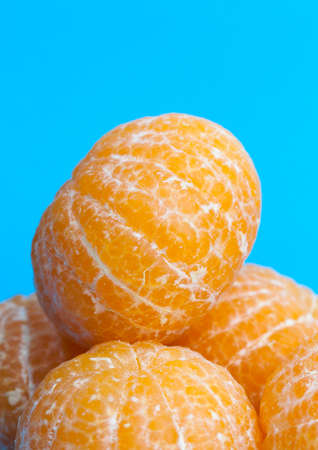 peeled delicious tangerine ready for food, pieces lying on the table, close-up Stock Photo