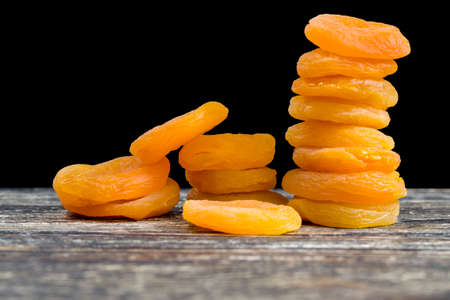beautiful dried apricots using chemical reagents to enhance the color of dried fruits, close-up of traditional sweets Stock Photo