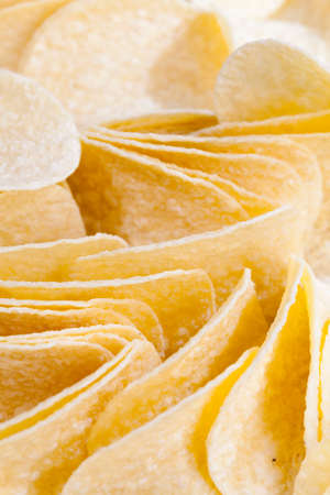 potato chips, close up of chips with a Golden color, harmful high-calorie food, chips are real and crispy Stock Photo
