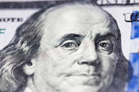 new banknote one hundred American dollars in cash, close-up of real banknotes Banco de Imagens