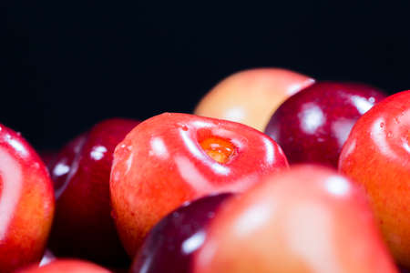close-up colorful ripe berries of a sweet cherry lying together, natural food from a home orchard