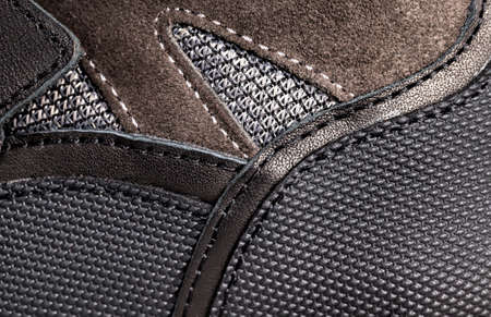 qualitatively sewn on the production of new shoes, close-up of natural leather and artificial materials from which shoes are made for people