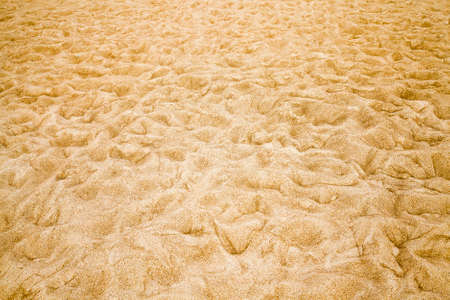 wavy uneven structure of sand on the beach on the sea, close-up of soft fine sand on the seashore Banco de Imagens