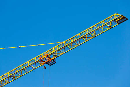 one construction metal crane for building houses with a large number of floors, against the sky