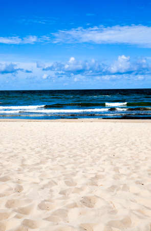 empty without people seashore during summer vacation, the Baltic sea in August, on the surface of the sea water waves