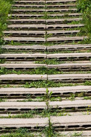 homemade stairs made of concrete slabs with hollow inside, close up grass Banco de Imagens
