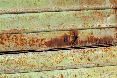 green-painted metal surface that still started to oxidize and rust, damaged metal, close up Banco de Imagens