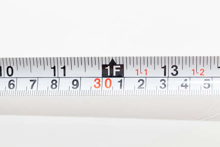 long ruler in centimeters and inches for use in construction activities, close-up