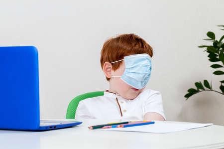boy in a medical mask