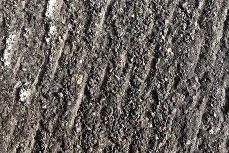 asphalt road that needs repaired